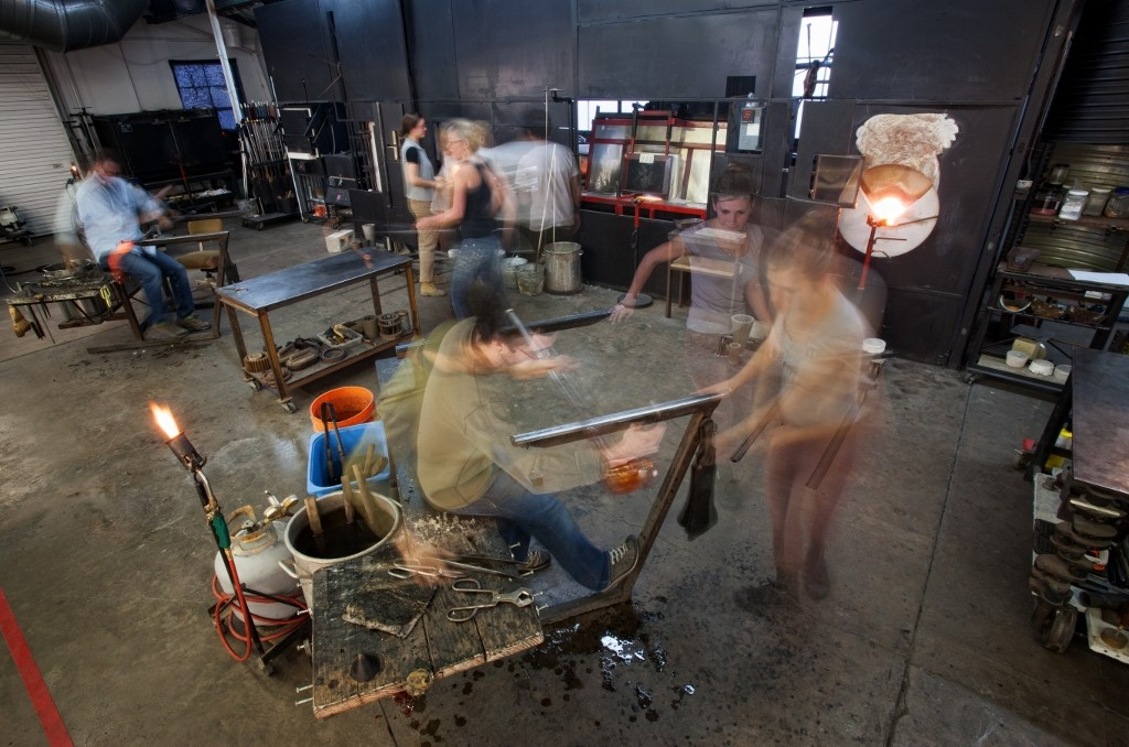 Busy Workers in Glass Workshop